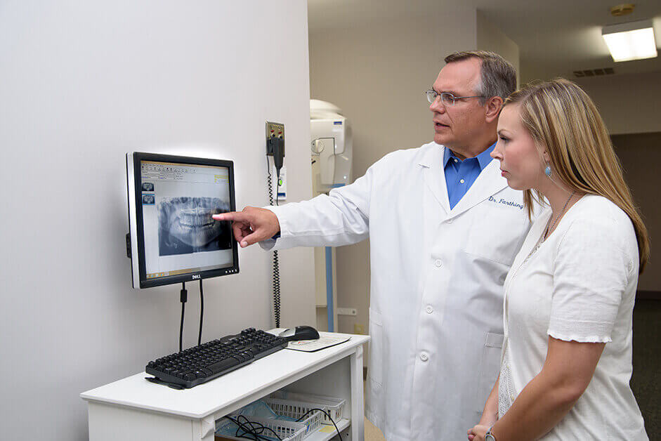 dentist pointing to x-ray