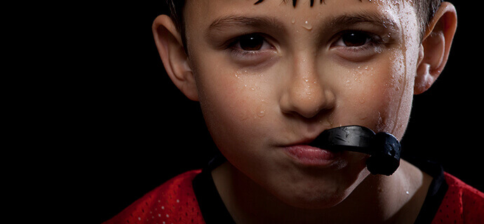young boy with mouthguard
