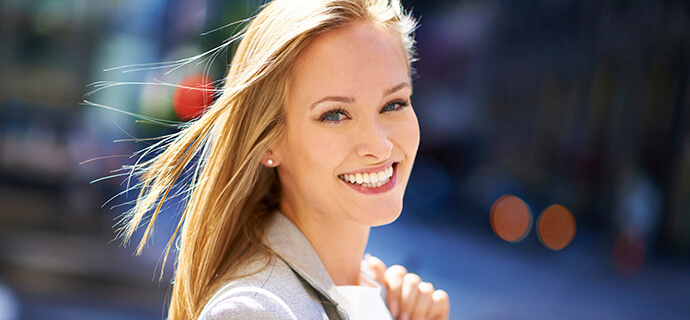 blonde woman smiling brightly