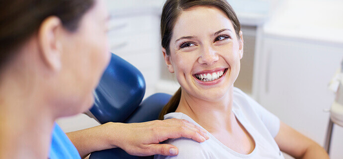 female patient smiling at dentist
