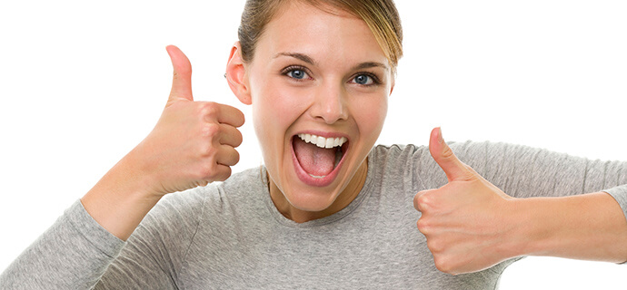 woman doing double thumbs up