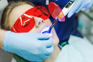 Patient receiving soft tissue laser dentistry service