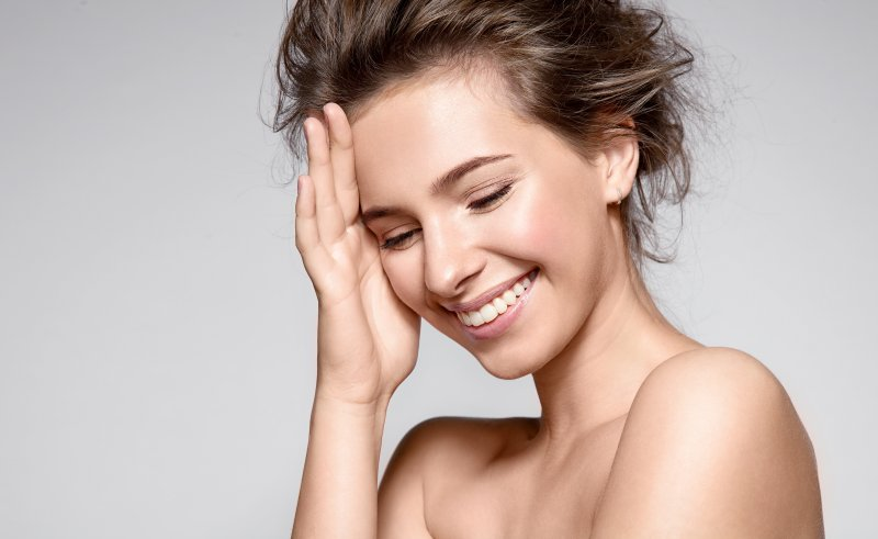 young attractive woman smiling after receiving cosmetic dental care