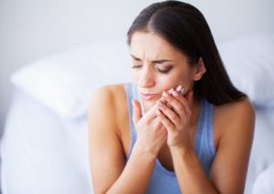 woman in pain from a dental emergency